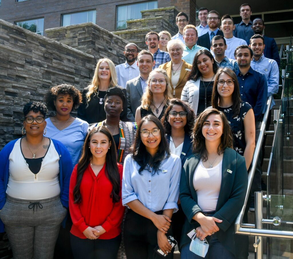Group photo of the 2021 FFAR Fellows, posing outside on the steps.